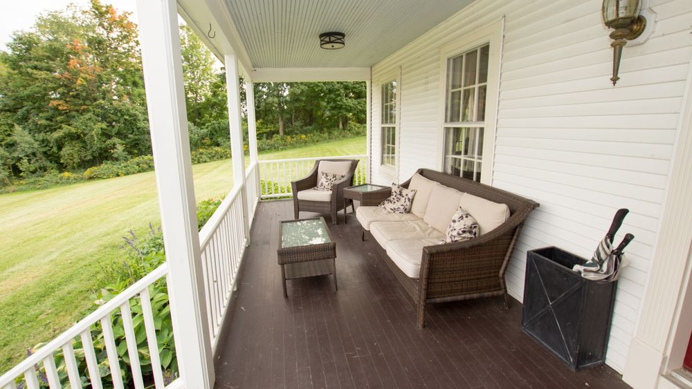 Farmhouse front porch.  Perfect for sipping coffee before the big day!
