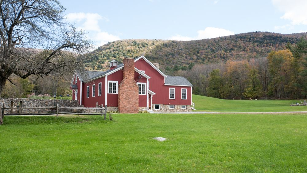 View of barn from outdoor tented reception site. (Victoria Boucher Photography)