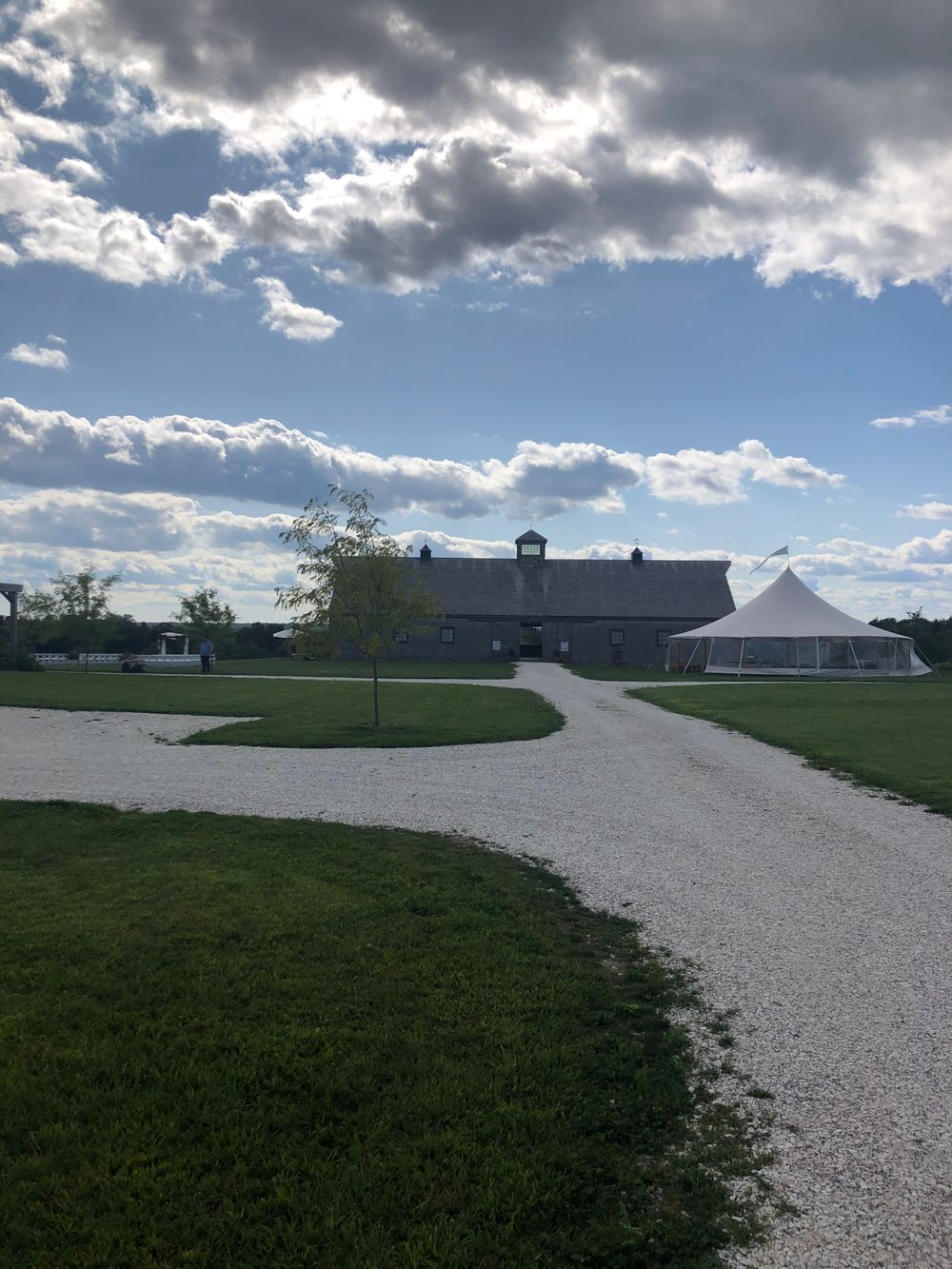 Looking west from the main road, at the Weatherlow barn set up with a ceremony on the south lawn and a cocktail tent on the north lawn, in September.