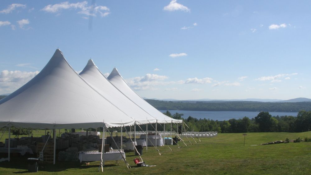 Sailcloth tent for tented reception with lake in the background.