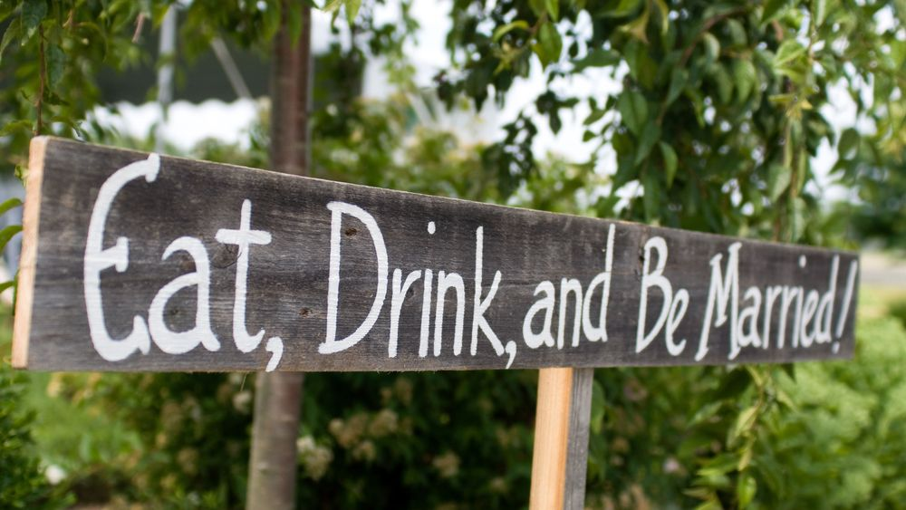 Sign welcoming guests. Photo Credit: Kat Mooney Photography